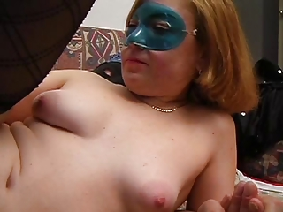Beautiful blonde in a blue mask gets fucked on her couch by big dick man