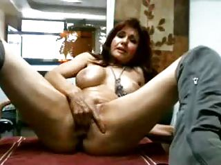 MILF in office on conf table masturbates and squirts