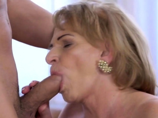 Salacious grandma admiring hard dick