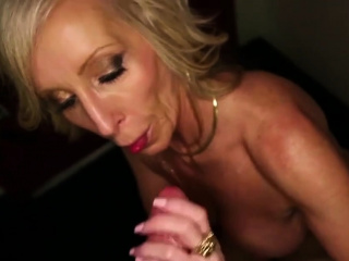 Busty tow-headed cougar wanking a hard wang