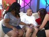 Two bitchy sluts jack off a small cock on the sofa