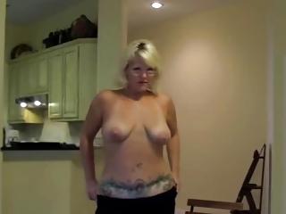 Blonde Milf Shows Her Tattooed Body